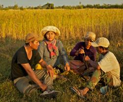 Moon with her husband and family in the rice fields